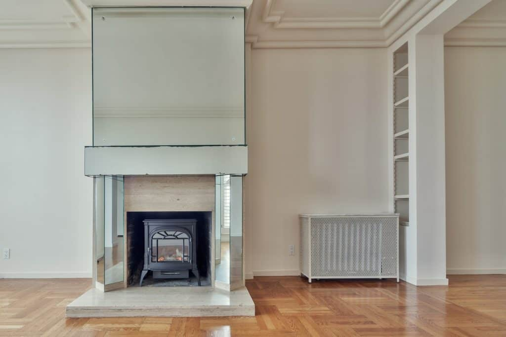 An empty room with a fireplace