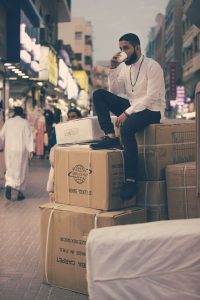 man sitting on boxes outdoors