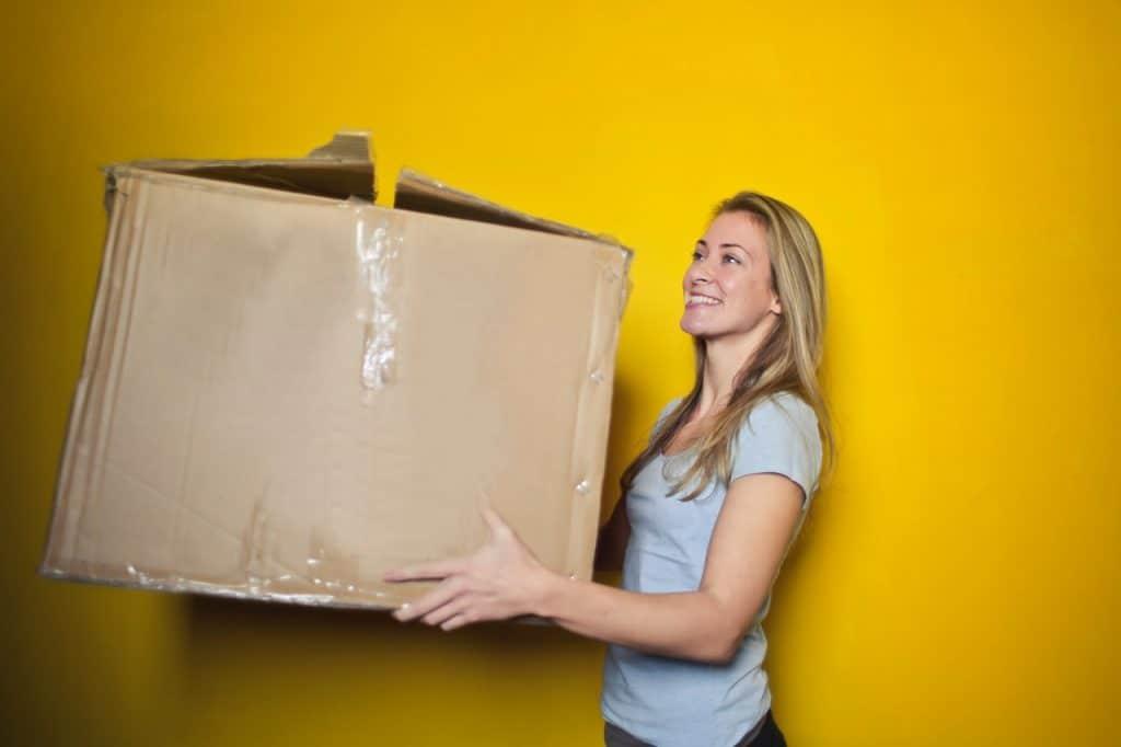 Blonde women holding a cardboard box