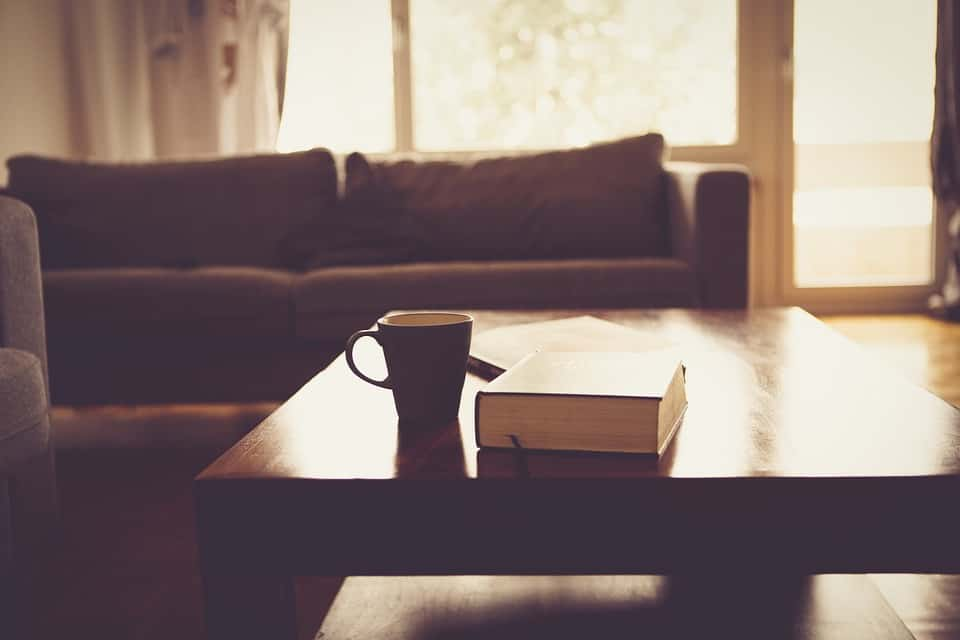 book and mug on coffee table