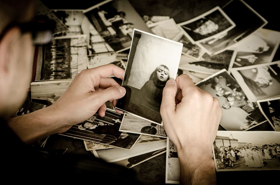 person looking at old photographs