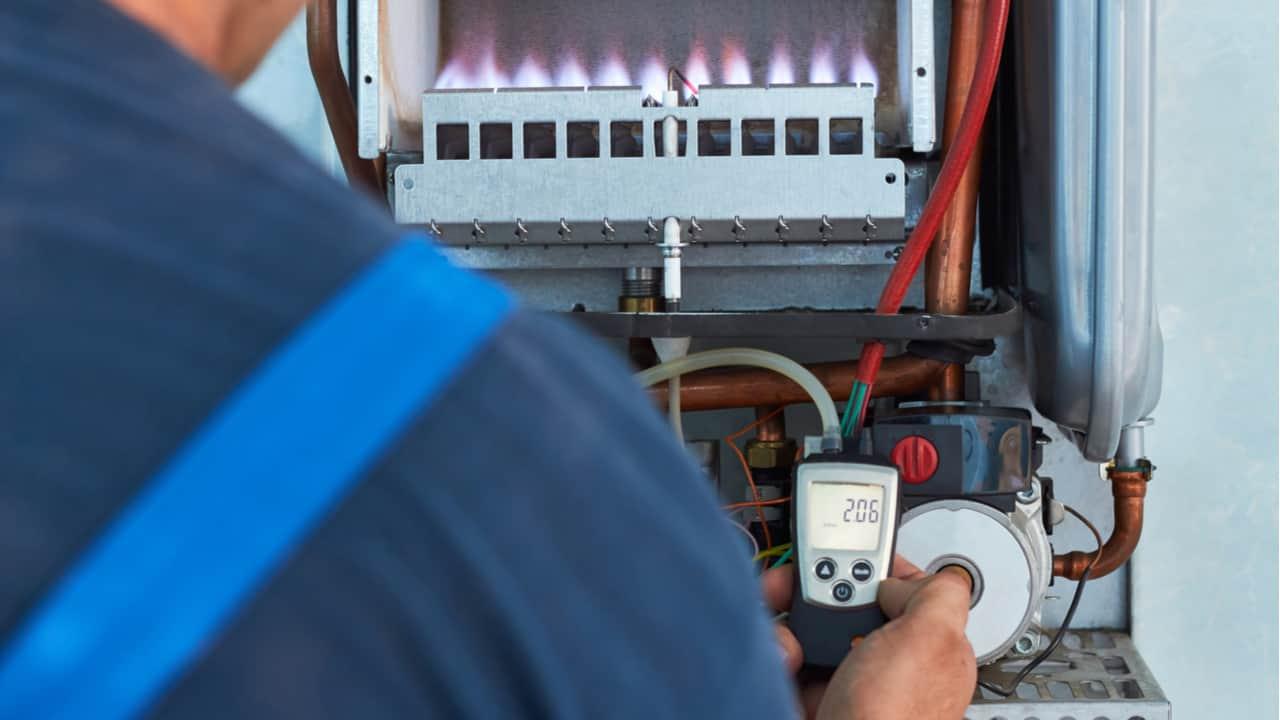 Man repairing a gas boiler