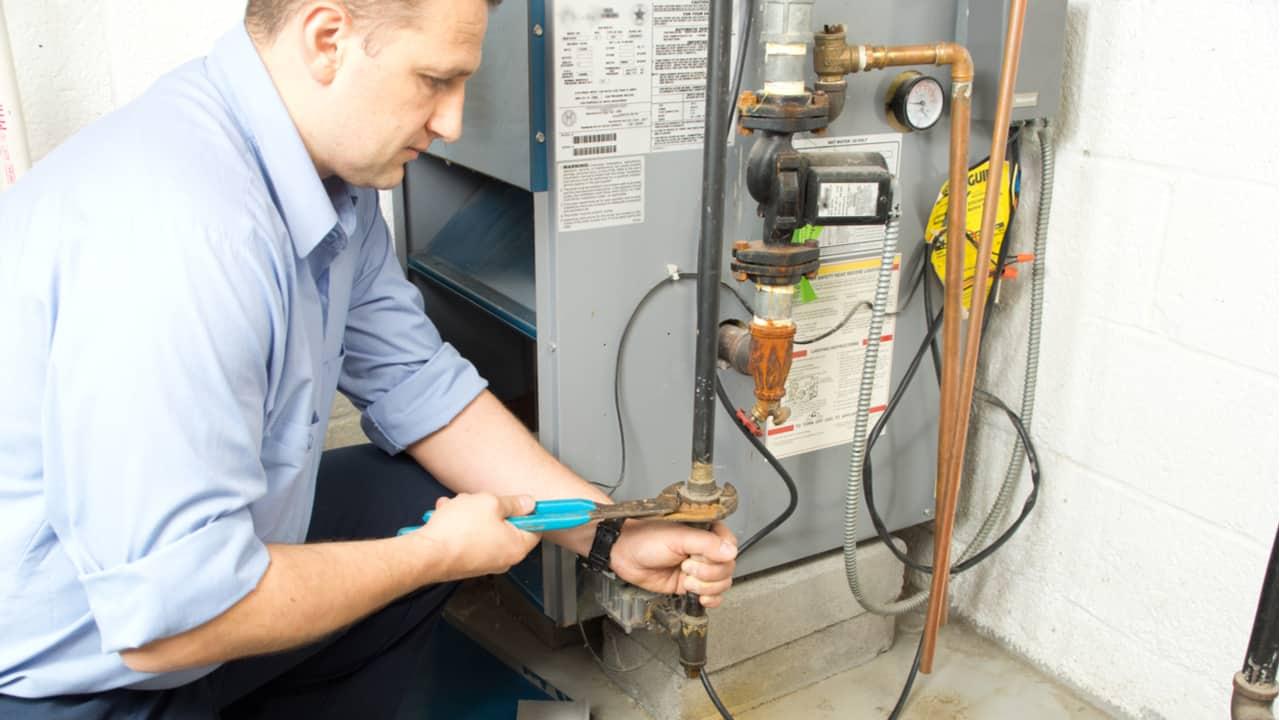 Man repairs furnace